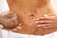 Woman-applying-body-scrub.jpg